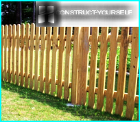 Wooden picket fence with their hands: on the construction management